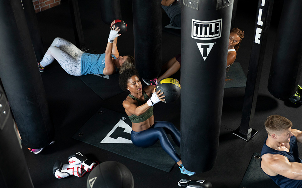 Abdominal workout in Somerville, MA at TITLE Boxing Club Boston Assembly Row.