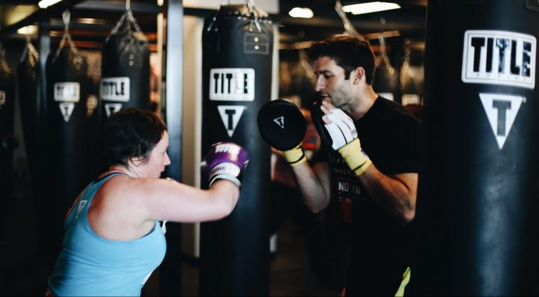 trainer coaching woman at title