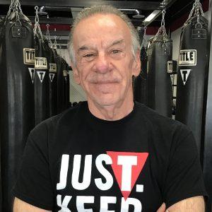 man in black title shirt