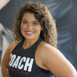 woman in title coach tank